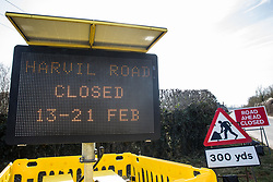 Harefield, UK. 13th February, 2021. A sign indicates the closure of Harvil Road in the Colne Valley in order to facilitate the felling of some of the few remaining trees in the area for the HS2 high-speed rail link. Four anti-HS2 activists had been evicted from a roadside camp and three from nearby trees by bailiffs acting for HS2 Ltd during the night.