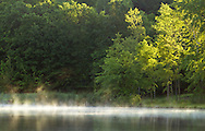 Middletown, New York - Mist moves across the lake at Fancher-Davidge Park on a cool spring morning on June 5, 2012.