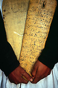 A librarian in Chingetti, Mauritania, holding a 'lah' or wooden tablet on which is inscribed verses of the Koran.<br /> Chinguetti was a 'ksar' or medieval trading centre that was founded in the 6th century and for centuries the city was a principal gathering place for pilgrims of the Maghrib to gather on the way to Mecca. It is known for it's ancient libraries full of priceless books and Korans and is said to be the seventh holiest city in Islam