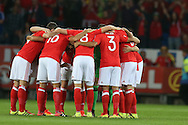 Ashley Williams, the Wales captain © gives a final talk as Wales players huddle together ahead of k/o. Wales v Moldova , FIFA World Cup qualifier at the Cardiff city Stadium in Cardiff on Monday 5th Sept 2016. pic by Andrew Orchard, Andrew Orchard sports photography