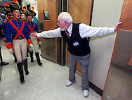 Fred Shadle, the elder statesman at age 83, historian and backstage manager for the Sacramento Ballet, directs cast soldiers through the door to the stage just prior to their appearance in the Nutcracker ballet on opening night of the annual Christmas season production, Thursday, December 6, 2000.  For 20 years Fred Shadle has volunteered his time to work backstage during the ballet season.