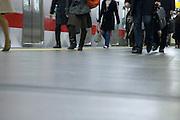people going to work walking train station Japan Tokyo