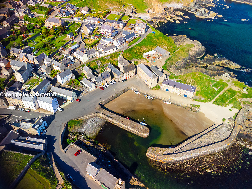 Aerial of historic harbours and village at Portsoy in Aberdeenshire on the Moray Firth, Scotland, UK