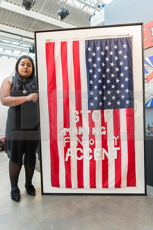 """Licensed to London News Pictures. 06/10/2016. London, UK. Artist, Marium M Habib, from Karachi, Pakistan, shows her work """"Stop Making Fun of My Accent"""" at the preview of Moniker Art Fair, part of London Art Week, taking place at the Old Truman Brewery, near Brick Lane.  Now in its seventh year, the fair embraces contemporary art from emerging and established artists, the majority of whom attend the fair in person in order to meet potential collectors and to show their work. Photo credit : Stephen Chung/LNP"""