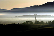 Early morning mist on over Killarney Town with the spire of St Mary's Cathedral rising above the fog viewed from Aghadoe, early on Christmas Eve.<br /> Picture by Don MacMonagle -macmonagle.com
