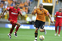 Photo: Paul Greenwood. <br />Wolverhampton Wanderers v Watford. Coca Cola Championship. 11/08/2007. <br />Wolves Michael Kightly (R) runs away with the ball from Jobi McAnuff