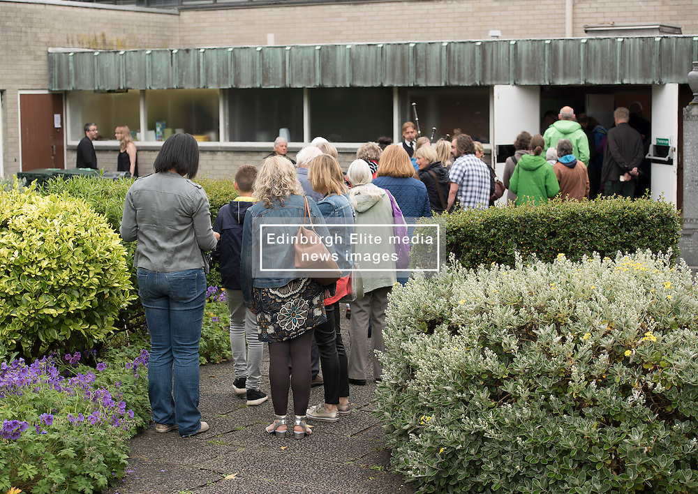 Pictured: People queuing to get in<br /> The community in Portobello came out last night in support of a locally organised campaign to try and save a local church and its attached church hall for the community. No longer needed by the church, who plan to sell it, the hall is widely used by community groups. The campaign hopes to make use of Scottish community buy-out legislation that has recently been extended to cover urban areas in one fo the first such campaigns in a Scottish urban area. Local film acting couple, Shauna Macdonald and Cal MacAninch, were instrumental in the event that featured a variety of local talent and was attended by about 150 people, packing out the church hall. Shauna brought the show together, along with her sister Kyrsta, and Cal performed on stage in both the specially written short play that opened the evening and singing with the band Hooseband at the show's finale.  <br /> <br /> <br /> <br /> <br /> © Jon Davey/ EEm