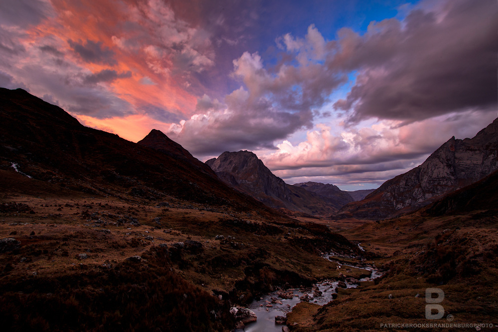 A dramatic sky at sunset in the Cordillera Blanca in the Andes Mountains of Peru.