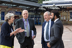 Theresa May, Conservative MP for Maidenhead, speaks to Cllr Gerry Clark (Royal Borough of Windsor and Maidenhead's cabinet member for transport and infrastructure), Bob Beveridge (chair of the Thames Valley Berkshire Local Enterprise Partnership) and Asim Zeb (Project Centre) on the occasion of the official opening of a new station forecourt on 11th October 2021 in Maidenhead, United Kingdom. The £3.75m refurbishment is intended to make the area around the station more commuter-friendly in anticipation of an increase in passengers when Crossrail opens and to improve both the interchange between trains and other forms of transport and walking and cycling links between the station and the town centre.