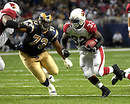 Arizona Cardinals running back Edgerrin James (32) rushes up field past St. Louis defensive tackle Jimmy Kennedy in the first half at the Edward Jones Dome in St. Louis, Missouri, December 3, 2006.  The Cardinals beat the Rams 34-20.<br />