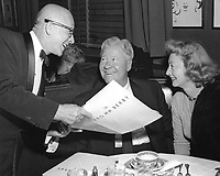 1944 Maitre d' Gus Constance shows menu to Jack Oakie and his wife at the Hollywood Brown Derby.