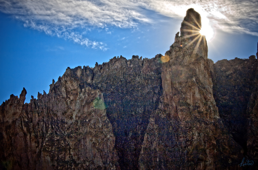 Sunburst behind the rock faces at Smith Rock State Park in eastern Oregon.