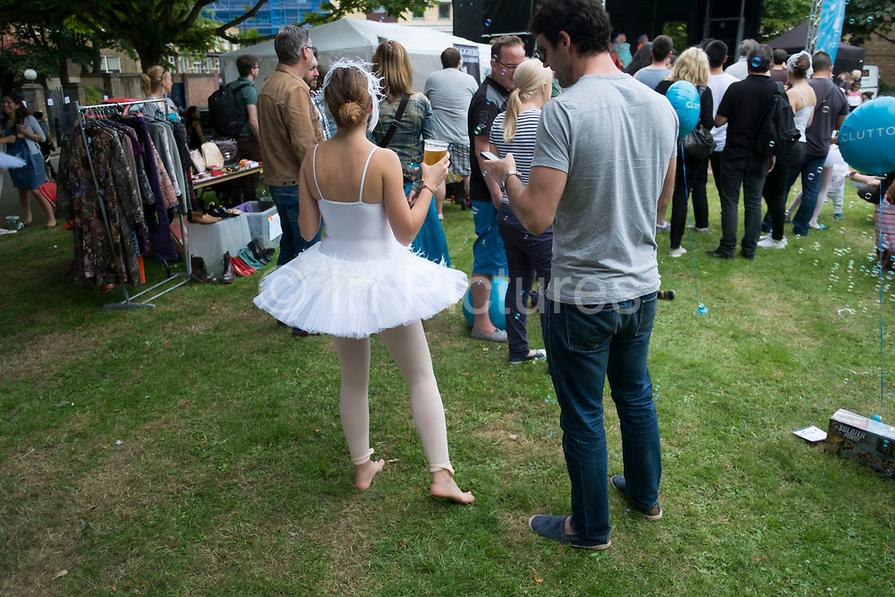 Ballet dancer from the Ruggieri Dance Academy has a pint of beer after performance at a local Summer event in Wapping, London, England, United Kingdom. (photo by Mike Kemp/In Pictures via Getty Images)