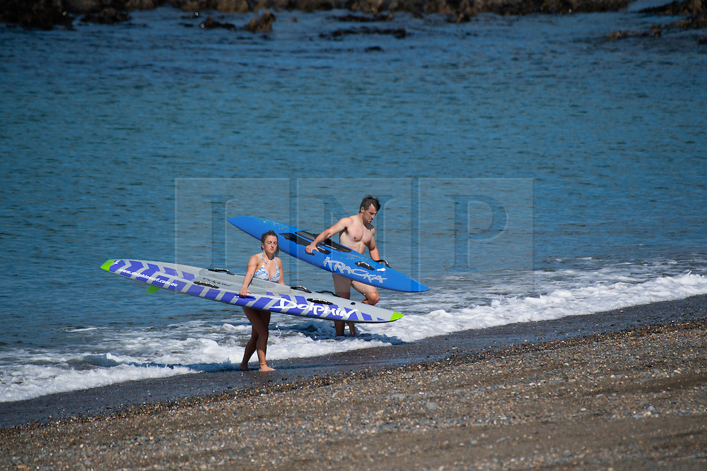 © London News Pictures. 15/08/2016. Aberystwyth .UK.<br />  People enjoying the warm summer sunshine on the beach and in the sea Aberystwyth on the west wales Coast. The weather is set to improve over the next two days, culminating in a mini-heatwave on Wednesday, with temperatures forecast to reach the high 20s or low 30s centigrade. Photo credit: Keith Morris/LNP
