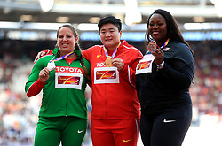 China's Lijiao Gong celebrates with her gold medal, Hungary's Anita Marton (left) with the silver and USA's Michelle Carter (right) with the bronze on the podium after the Women's Shot Put Final during day seven of the 2017 IAAF World Championships at the London Stadium.