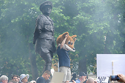"""© Licensed to London News Pictures. 29/05/2017. London UK. Demonstrators stage an """"Anti-Hunting March"""" in central London, marching from Cavendish Square to outside Downing Street.  Protesters are demanding that the ban on fox hunting remains, contrary to reported comments by Theresa May, Prime Minister, that the 2004 Hunting Act could be repealed after the General Election.<br />  Photo credit : Stephen Chung/LNP"""