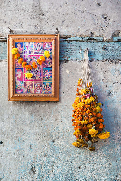 Hindu offering of flowers on old wall