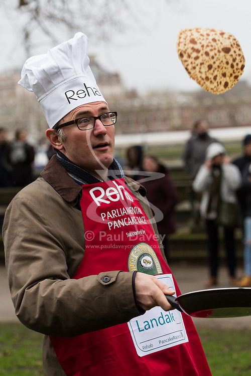 MPs and members of the House of Lords compete in the annual Rehab pancake race, a relay of eleven laps in Victoria Tower Gardens adjacent to the Houses of Parliament in London. The race is held every year on Shrove Tuesday and was won by the Media team. PICTURED: James Landale, BBC Diplomatic Correspondent.  London, February 13 2018.