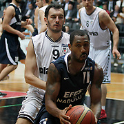 Besiktas's Bekir YARANGUME (L) and Efes Pilsen's Bootsy THORNTON (R) during their Turkish Basketball league derby match Besiktas between Efes Pilsen at the BJK Akatlar Arena in Istanbul Turkey on Saturday 30 April 2011. Photo by TURKPIX