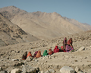 Women gathering during a Wakhi funeral. Forty days after the death of Saidol, the former mayor, a ceremony is celebrated in his honor. The traditional life of the Wakhi people, in the Wakhan corridor, amongst the Pamir mountains.