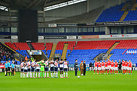The Bolton Wanderers and Fleetwood Town players stand for a minutes silence prior to the match<br /> <br /> Photographer Richard Martin-Roberts/CameraSport<br /> <br /> The EFL Sky Bet League One - Bolton Wanderers v Fleetwood Town - Saturday 2nd November 2019 - University of Bolton Stadium - Bolton<br /> <br /> World Copyright © 2019 CameraSport. All rights reserved. 43 Linden Ave. Countesthorpe. Leicester. England. LE8 5PG - Tel: +44 (0) 116 277 4147 - admin@camerasport.com - www.camerasport.com
