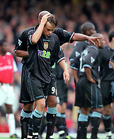 Lee Hendrie is shown off the pitch by Dion Dublin (Aston Villa) after being shown the red card. Arsenal v Aston Villa. FA Premiership, 14/10/00. Credit: Colorsport.
