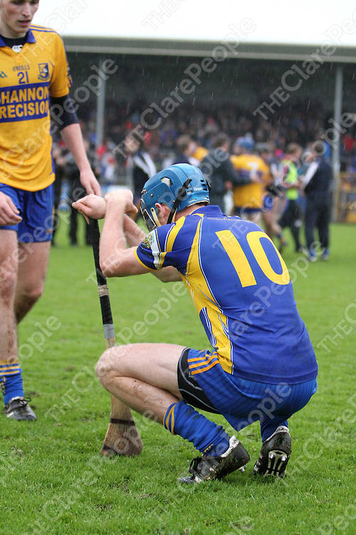 10/11/13 A dejected Newmarket On-Fergus's David Barrett is consoled by Sixmilebridge's John Fennessey after the Senior Hurling County Final in Cusack Park. Pic Tony Grehan / Press 22
