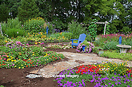 63821-21901 Flower garden with blue Adirondack chair, bird bath, butterfly house and blue bird house. Butterfly Bushes, Peach & Purple Verbenas, Yellow Lantana (Lantana camara), Karl Forster Grass, Black-eyed Susans (Rudbeckia hirta), Homestead Purple Verbena (Verbena canadensis), Red Verbena, New Gold Lantana (Lantana camara)  Marion Co., IL