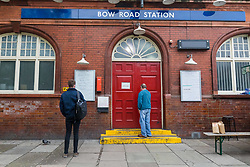 © Licensed to London News Pictures. 19/03/2020. London, UK. People outside Bow Road tube station in London which closed this morning. Transport for London (TfL) are closing a number of underground stations from today, as partial closure of the tube and rail network begins in response to the growing coronavirus outbreak in the captial. Photo credit: Vickie Flores/LNP