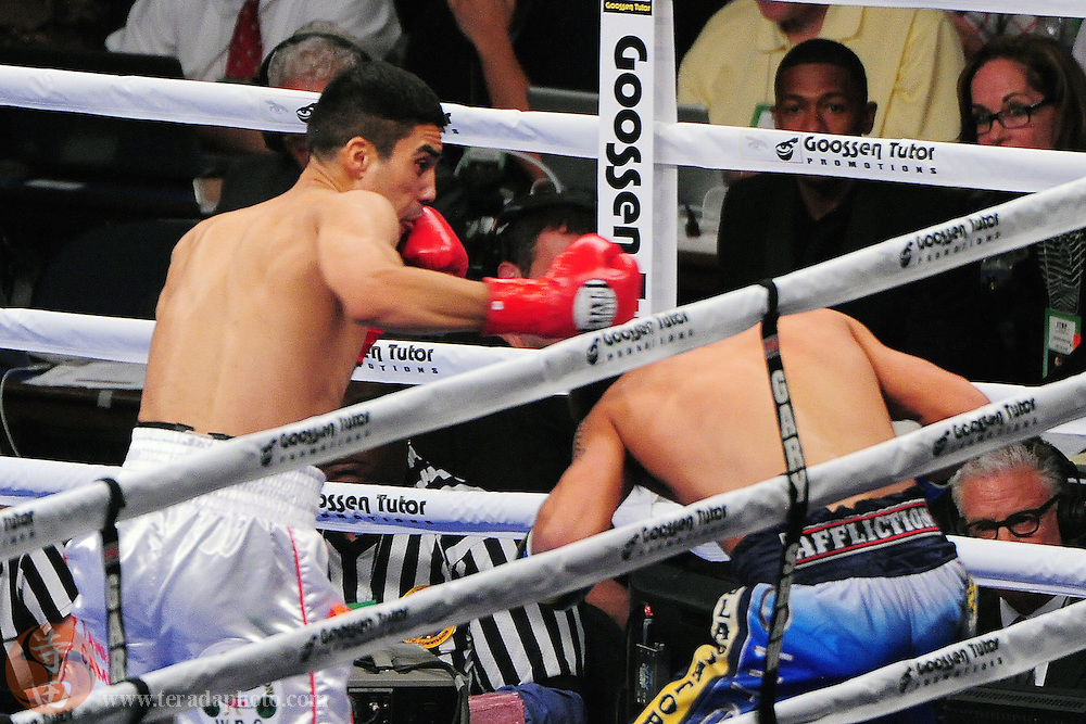 September 8, 2012; Oakland, CA, USA; Antonio DeMarco (red gloves) fights John Molina Jr. (blue gloves) during the WBC lightweight championship at ORACLE Arena.
