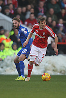Birmingham City's Andrew Shinnie (L) and Nottingham Forest's Robert Tesche in action during todays match  <br /> <br /> Photographer Jack Phillips/CameraSport<br /> <br /> Football - The Football League Sky Bet Championship - Nottingham Forest v Birmingham City - Saturday 28th December - The City Ground - Nottingham<br /> <br /> © CameraSport - 43 Linden Ave. Countesthorpe. Leicester. England. LE8 5PG - Tel: +44 (0) 116 277 4147 - admin@camerasport.com - www.camerasport.com