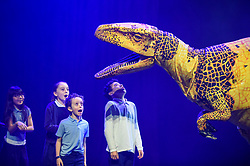 © Licensed to London News Pictures. 13/02/2020. LONDON, UK. Pupils from Stockwell Primary School meet a Fukui raptor from Erth's Dinosaur Zoo, one of the acts forming part of Imagine Children's Festival at Southbank Centre for half term 12 to 23 February 2020. (Permission to photograph obtained from schools teacher).  Photo credit: Stephen Chung/LNP