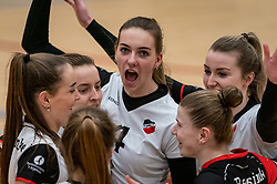Emma Bredewoud of Apollo 8, Kim Klein Lankhorst of Apollo 8, Juliët Huisman of Apollo 8 celebrate during the first league match between Laudame Financials VCN vs. Apollo 8 on February 06, 2021 in Capelle aan de IJssel.