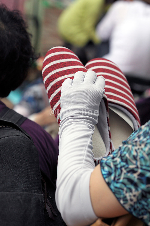 woman wearing a UV protection arm cover Japan