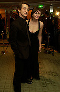 Hugh Dancy and Emily Mortimer. 25th  annual Awards of the London critic's Circle in aid of the NSPCC. The Dorchester. Park Lane. London. 9 February 2005. ONE TIME USE ONLY - DO NOT ARCHIVE  © Copyright Photograph by Dafydd Jones 66 Stockwell Park Rd. London SW9 0DA Tel 020 7733 0108 www.dafjones.com