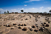 The square in Dourou village in the Bandiagara Escarpment. The Dogon Country is the most visited part of Mali with tourists visiting its tipical  villages that can be located on the cliff, on the sandy plain or in the rocky plateau