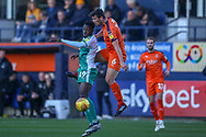 Luton Town defender Matthew Pearson (6) in the air with Plymouth Argyle forward Freddie Ladapo (19) during the EFL Sky Bet League 1 match between Luton Town and Plymouth Argyle at Kenilworth Road, Luton, England on 17 November 2018.