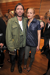 MATT COLLISHAW and POLLY MORGAN at a party in aid of the charity Best Buddies held at the Hogan store, 10 Sloane Street, London SW10 on 13th May 2009.
