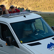 Teten Science Schools tour participants watch a herd of elk forage in the early morning hours.