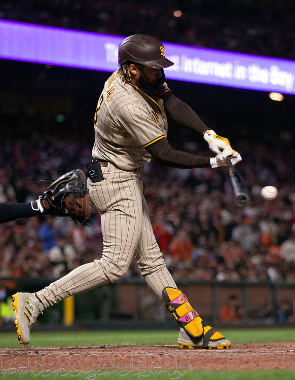 Oct 1, 2021; San Francisco, California, USA; San Diego Padres shortstop Fernando Tatis Jr. (23) connects for a double against the San Francisco Giants during the eighth inning at Oracle Park. Mandatory Credit: D. Ross Cameron-USA TODAY Sports