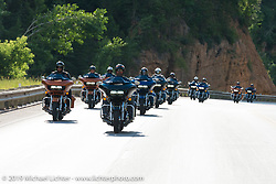 Riding from Deadwood to Sturgis, SD with actor Geoff Stults at the lead (front left) for the reveal of the new Harley-Davidson Road Glide during Sturgis Black Hills Rally. SD, USA. August 1, 2014.  Photography ©2014 Michael Lichter.