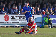 Charlton Athletic attacker Lyle Taylor (9) sat on pitch smiling during the EFL Sky Bet League 1 match between AFC Wimbledon and Charlton Athletic at the Cherry Red Records Stadium, Kingston, England on 23 February 2019.