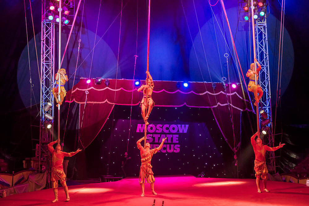 The Alikhanov Troupe  perform on three ten meter pole's balanced on the shoulders of a men and then the 3 girls climbone pole - Moscow State Circus returns to London with it's latest show GOSTINITSA in a centrally heated theatre style Big Top on Hampstead Heath. They will be there from Wed 27th Sept to Sun 1st Oct.