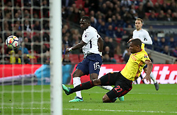Tottenham Hotspur's Moussa Sissoko (left) misses a chance on goal while under pressure from Watford's Christian Kabasele during the Premier League match at Wembley Stadium. London.