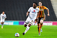 MK Dons' Forward Cameron Jerome (35) and Hull City defender Jacob Greaves (24) during the EFL Sky Bet League 1 match between Milton Keynes Dons and Hull City at stadium:mk, Milton Keynes, England on 21 November 2020.