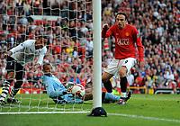 Dimitar Berbatov Scores 5th goal past Tottenham Hotspurs Heurelho Gomes<br /> Manchester United 2008/09<br /> Manchester United V Tottenham Hotspur (5-2) 25/04/09<br /> The Premier League<br /> Photo Robin Parker Fotosports International