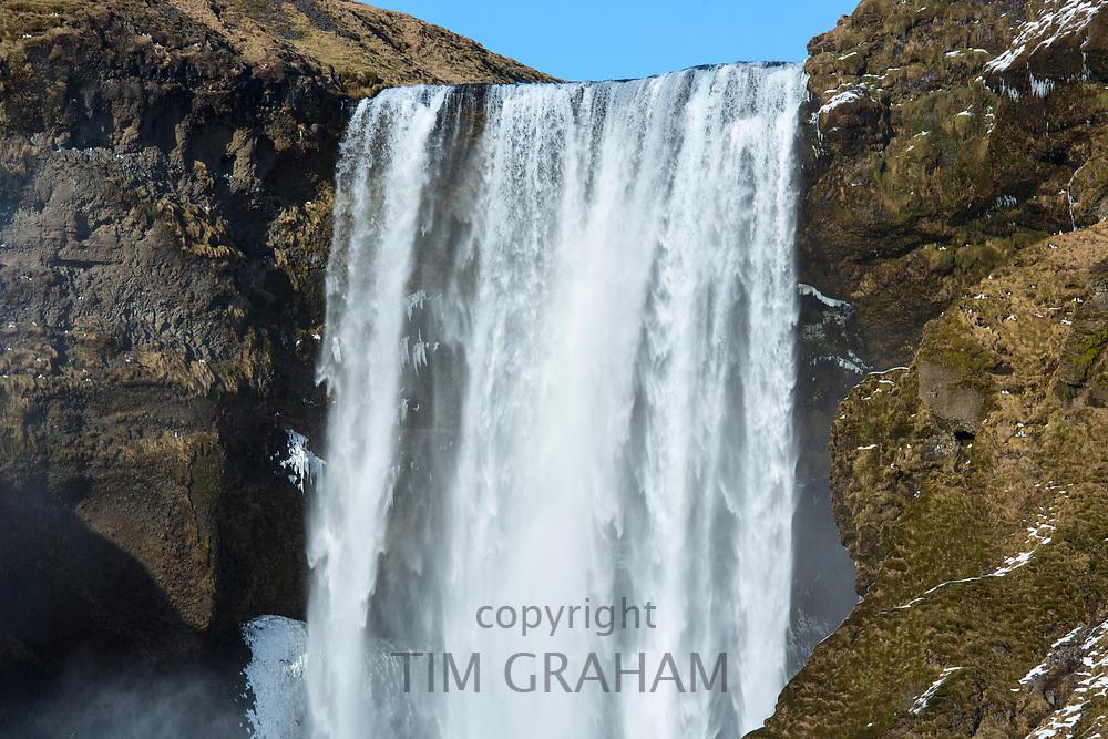Spectacular water falls Skogar waterfall - Skogarfoss - in South Iceland with gushing glacial melting waters