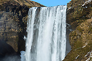 Spectacular water falls Skogar waterfall - Skogarfoss - in South Iceland with gushing glacial melting waters
