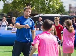 © Licensed to London News Pictures. 13/08/2019; Bristol, UK. JONNY WILKINSON, former England Rugby international who won the Rugby World Cup with England in 2003, coaches children at touch rugby at the Wear the Rose Live event at the Lloyds Amphitheatre on Bristol Harbourside. England's 31-man squad for the Rugby World Cup in Japan will be attending the event in Bristol on Tuesday. The free-of-charge Wear the Rose Live from England sponsor O2 will see the full squad and coaches and special guest Jonny Wilkinson spend an afternoon in Lloyds Amphitheatre.<br /> The event will feature live music alongside a variety of carnival stalls and rugby games, manned by the players, with a chance for fans to win prizes. Photo credit: Simon Chapman/LNP.
