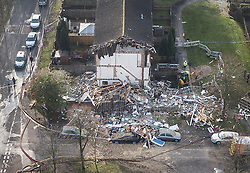 © Licensed to London News Pictures. 27/12/2018. Andover, UK. The ruins of a house are seen in Andover, Hampshire where a body has been pulled from wreckage, following an explosion in the property. Residents have been evacuated form the area following a blast in the early hours of this morning. Photo credit: Peter Macdiarmid/LNP